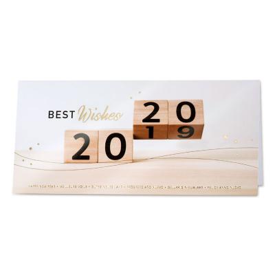 Geschäftliche Neujahrskarte mit Jahreszahl auf Holzwürfel (849.005)