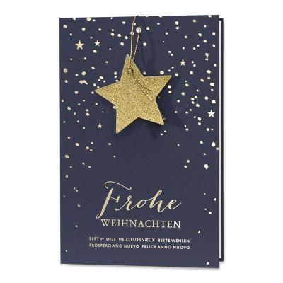 Weihnachtskarte für Unternehmen mit Sternanhänger im Schneetreiben (868.079)